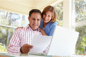 Hispanic couple at computer